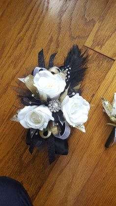Black white and gold prom corsage from Hen House Designs www.henhousedesigns.net