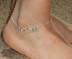Silver plated ankle bracelet with an infinity symbol connector and 4mm turquoise gemstones. The length of the anklet measures approx 24cm or 9.5.  Every item from Gemma Jolee comes ready for gift giving.  Please contact me if you have any questions.  Thanks for looking.  To view other ankle bracelets, please click here http://www.etsy.com/uk/shop/GemmaJolee?section_id=13769458  To view other items in the shop click here http://www.etsy.com/uk/shop/GemmaJolee?ref=si_shop