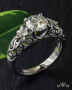 ● Lily Blossom Engagement Ring ●  Platinum swirls dance down the shoulders and around the hand carved #lily blossoms of this demure #Antique style #engagementring. #Ido #GreenLakeMade #Floral #Jewelry