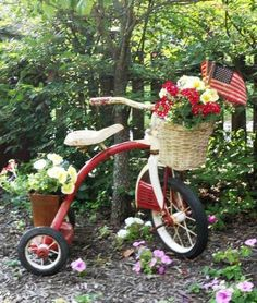 aging pots and metal in the garden **Love this idea for an old tricycle that you can't part with, I may have to do something with my girls old wagon!
