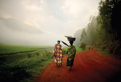 Photo by Charles Harris.    Workers walking back from the tea fields of central Rwanda.
