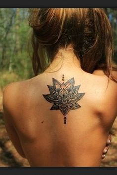 placement; Lotus on back— would definitely get as a henna tattoo