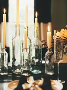 Instead of frightening decorations, conjure up a spookier atmosphere by limiting your light sources. Skip the overhead lamp at the dinner table in favor of candles – traditional- or antique-style candlestick holders work best. via Style Me Pretty