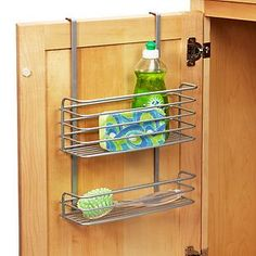 Utilize the often-wasted space between your cabinet shelves with our functional and attractive Polytherm Undershelf Baskets.  Available in three sizes and an attractive silver finish, these shelves instantly add storage space to your kitchen cabinets for storing mugs, cups, linens and more.  The baskets feature flat wires that offer a secure, snug fit on your existing shelf.  The wide opening of the basket allows easy access to the interior. Door Organizer, Cabinet Organizers, Storage Shelves, Elfa Shelving, Bath Storage, Kitchen Cabinet Storage, Cabinet Drawers, Storage Ideas, Storage Room