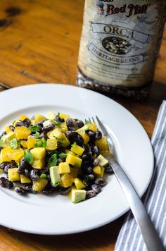 Fresh and zingy Avocado & Mango Orca Bean Salad with jalapenos, lime and citrus | Bob's Red Mill