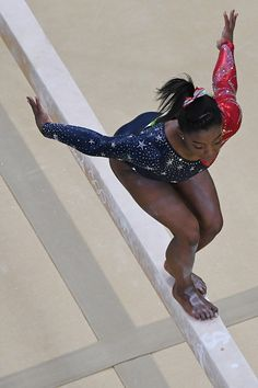 US gymnast Simone Biles competes in the qualifying for the women's Beam event of the Artistic Gymnastics at the Olympic Arena during the…
