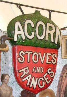 Spendid vintage Acorn Stoves and Ranges sign.