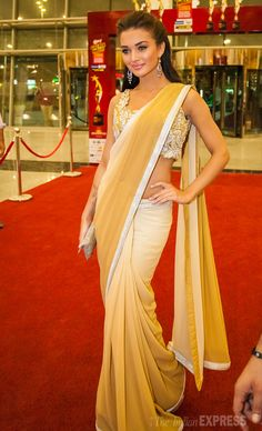 Amy Jackson looked gorgeous as she posed for shutterbugs in a white-beige Neeta Lulla sari paired with an embellished blouse at SIIMA Awards 2013 Indian Wedding Outfits, Indian Outfits, Indian Clothes, Wedding Dresses, Bollywood Fashion, Bollywood Actress, Bollywood Style, Indian Bollywood, South Indian Actress