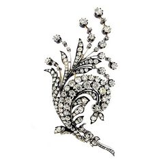 Antique diamond spray brooch, circa 1880 A gold and silver brooch in the form of a swirling spray of leaves set with one hundred and fifty eight round old cut diamonds in silver with an approximate total weight of 15.00 carats, with pierced back throughout, the reverse mounted with a gold pin.