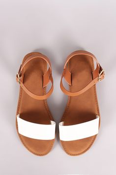 832db7ef24f7 This flat sandal features a single band across vamp