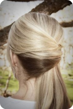 Pretty Side Ponytail variation. Looks like a half French twist - hair is just folded over onto itself, but only it's to the side to make a formal ponytail