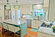 This kitchen definitely belongs in a beach house with all the teal accents, maybe even a little too much teal for my taste.