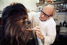 Ralph McQuarrie helping Chewie with his mouth.