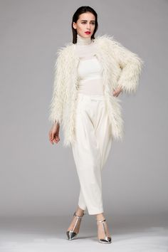 Longline faux fur coat. Click for latest price