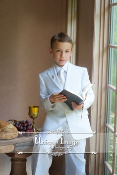 Unique Image Photography First Communion  Portraits. Communion suit ideas. Holy Communion inspiration.