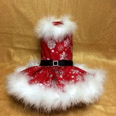 A personal favorite from my Etsy shop https://www.etsy.com/listing/487039139/little-mrs-santa-dog-dress