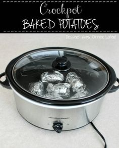 Crockpot Baked Potatoes - Throw some foil wrapped baked potatoes in the crock pot in the morning, turn it on, & have a baked potato bar for dinner in the evening! DessertNowDinnerLater.com #crockpot #slowcooker #dinner