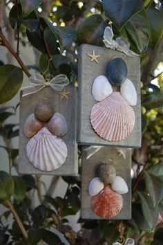 Handmade Sea Shell Angel is made with reclaimed pallet wood planks and assorted sea shells found in Southern California beaches. Each angel is
