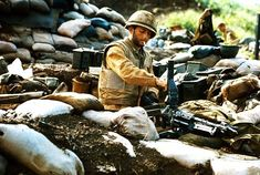 """Con Tien, Septemper 15th, 1967 - """"A young Marine cleaning his weapon, a rare photo of the M-60 on a tri-pod."""" ~ Vietnam War"""