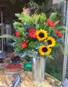 Thanksgiving dinning Alfresco sunflowers and gerbera daisies  Instyle Flowers 310-798-6195 www.instyleflowers.com