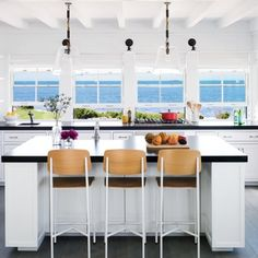 The mostly-white surfaces in this Buzzards Bay, Massachusetts, kitchen ensure that water and sky take center stage. | Coastalliving.com