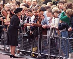 Queen Elizabeth II: After the death of Princess Diana on August 31, 1997, the Royal Family was perceived to be insensitve to the tragedy and to the outpouring of public grief by their remaining sequestered members at Balmoral Castle in Scotland. They eventually emerged. Here Elizabeth speaks to the public as she takes a walkabout at Saint James's Palace on September 5th where she paid her respects to Diana. (Photo Thomas Coex/AFP/Getty Images)