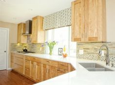 Kitchen remodel using Maple cabinets, quartz countertops, cool and calm blues and greens, and abundant storage for a large family with four children.