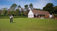 Fore! The house includes a driving range for its wealthy new owner to practice his golf putting