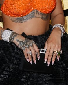 Rihanna Photos Photos - Singer Rihanna, jewelry detail, at The 59th Annual GRAMMY Awards at STAPLES Center on February 12, 2017 in Los Angeles, California. - FIJI Water At The 59th Annual GRAMMY Awards