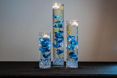 Submersible Blue/Purple/Pink/White/White with purple/Yellow Orchids Floral Wedding Centerpiece with Floating Candles and Acrylic Crystal Kit Blue Flower Centerpieces, Floating Candle Centerpieces, Floral Centerpieces, Floral Arrangements, Centerpiece Ideas, Deco Table Communion, Cylinder Vase, Purple Orchids, Floral Wedding