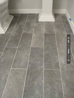 Wide plank tile for bathroom. Great grey color! would love for all bathrooms.