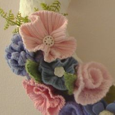 Custom Comforts. Good idea for recycling old sweaters. This is a gorgeous felt wreath. Click thru to see the beauty of the whole wreath.