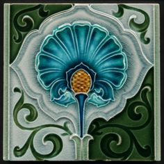 Pretty blue flower tile with white and green stem and surrounds. Antique Richards Art Nouveau Majolica Ceramic Tile.