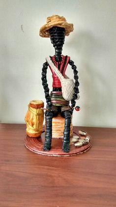 ELEGGUA elaborado en papel periódico by Creaciones HEIMAR Cardboard Box Crafts, Newspaper Crafts, Paper Weaving, Weaving Art, African Dolls, African Art, Paper Dolls, Art Dolls, African Paintings