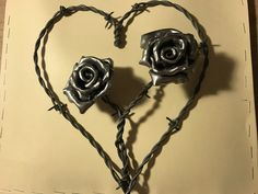 Hand forged steel roses