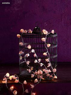 mini cupcake papers on string lights- via Avotakka