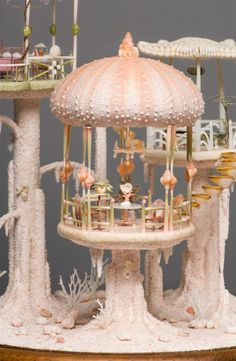 In all, this dollhouse is only nine inches tall and about seven inches wide. Everything you see, from the furniture to the structure itself, is made from various types of shell. So much detail! So incredible!