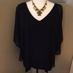 Cold shoulder top Cute black cold shoulder top. Camisole underneath with a sheer layer on top. There is a small hole in the sheer part but not noticeable. Tops Blouses