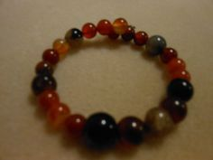 Bracelet memory wire one level multiple colors of by JewelrybyKN