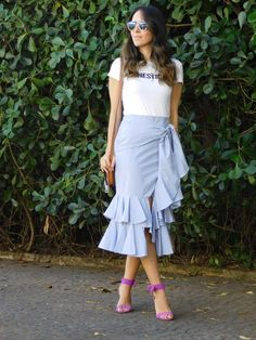 """Once again there's proof that the t-shirt became indispensable in our lives. Putting  it together with a ruffled skirt creates a modern outfit. After all, the tee """"takes away"""" the romanticism of the skirt. (Gabi May)"""