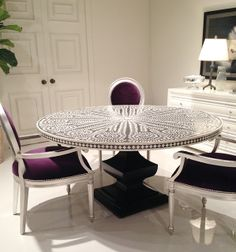 Inlaid Ivory Round Dining table with purple velvet chairs.   IVORY!  I SINCERELY HOPE NOT!!!!!