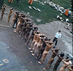 EDS NOTE NUDITY Prisoners with their hands on their heads and stripped of all clothes are