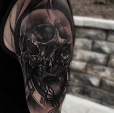 3D style very detailed shoulder tattoo of human skull with clock