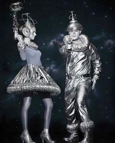 Cosmic couple, indeed: These shimmery space people are more Studio 54 than Area 51 (or any other alien hangout) in costumes crafted from everyday hardware-store supplies, including dryer tubing, pipe insulation, Mylar sheeting, and metal-repair tape.