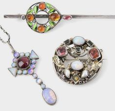 Bonhams : Sibyl Dunlop, attributed and George Hunt, attributed A Gem Set Brooch and a Pendant and a Gem Set Bar Brooch, circa 1920
