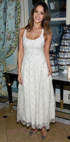 Jessica Alba was spring-ready at the launch of The Honest Company's Paris Diaper Collection in a custom silver lace Brock Collection dress, adding a futuristic edge with silver mirrored Manolo Blahnik pumps.
