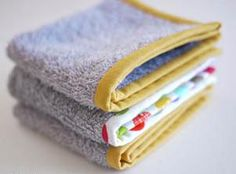 """byMichele Made Me How to Make: Cut old towel into squares and 4"""" strips of cotton to make binding. Attach binding to the old towel and don't forget to saw it either by hand or by machine. Match th..."""