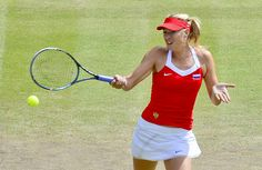 Russia'a Maria Sharapova returns the ball to Russian Maria Kirilenko during their women's single tennis match semi-Final at the London 2012 Olympic Games in London on August 3, 2012.