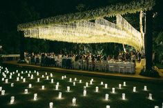 Next inspiration: A wedding reception set-up that is a complete definition of perfection! We are in awe with the canopy constructed with thousands of hand-strung twinkling lights that complement the open roof of the structure, creating a magical vibe. The additional lights scattered here and there surely adds in the prettiness! Isn't it magnificent? Show some love!  Decoration by @joerainforest via @wedluxe