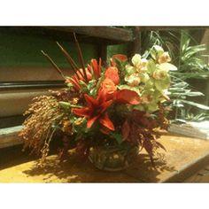Rust Lily, Green Cymbidium, Fall Grasses,  Orange Spray Roses in a Bubble Bowl